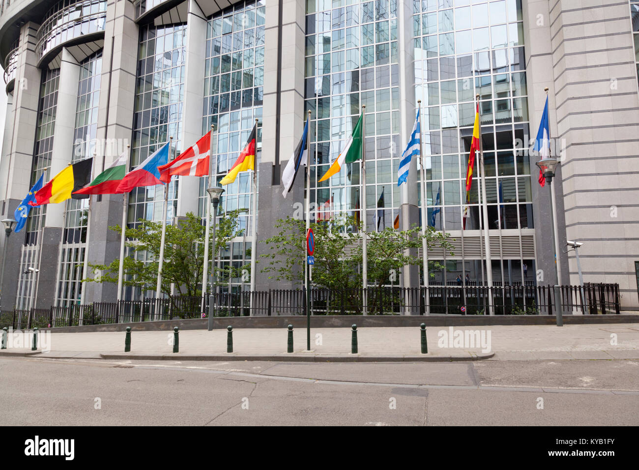 The European Parliament buildings in Brussels, Belgium with lots of European flags. - Stock Image