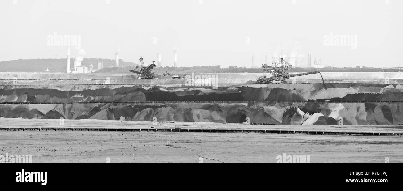 Panoramic view of a large lignite surface mine with bucket-wheel excavators and other large machines, two lignite Stock Photo