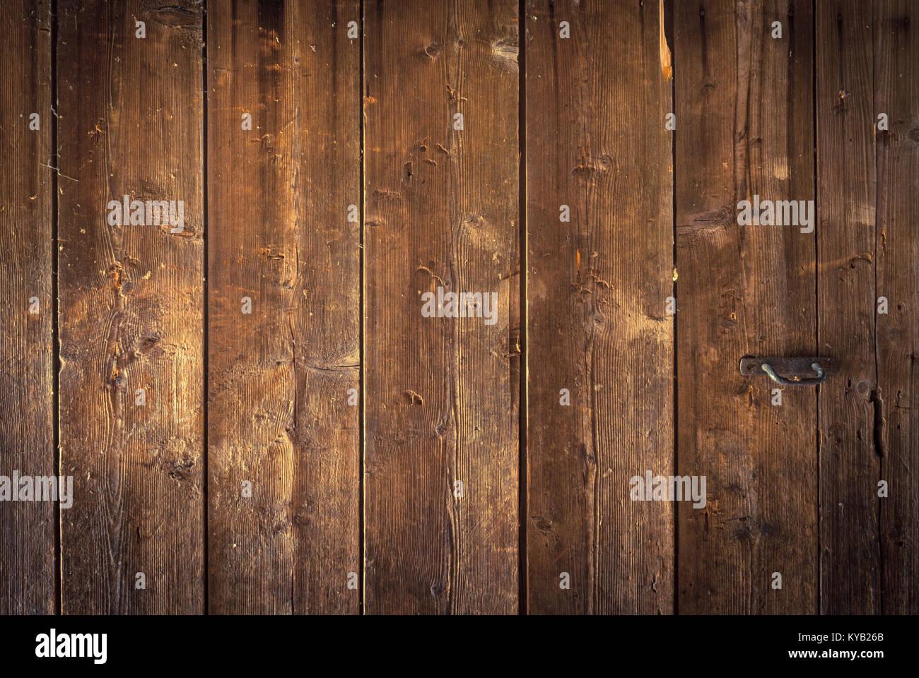 Part of the big old wooden doors of wide planks of old country house. & Part of the big old wooden doors of wide planks of old country house ...
