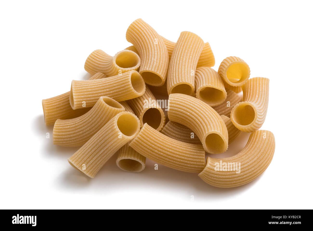 Spelt rigatoni pasta isolated on white background - Stock Image