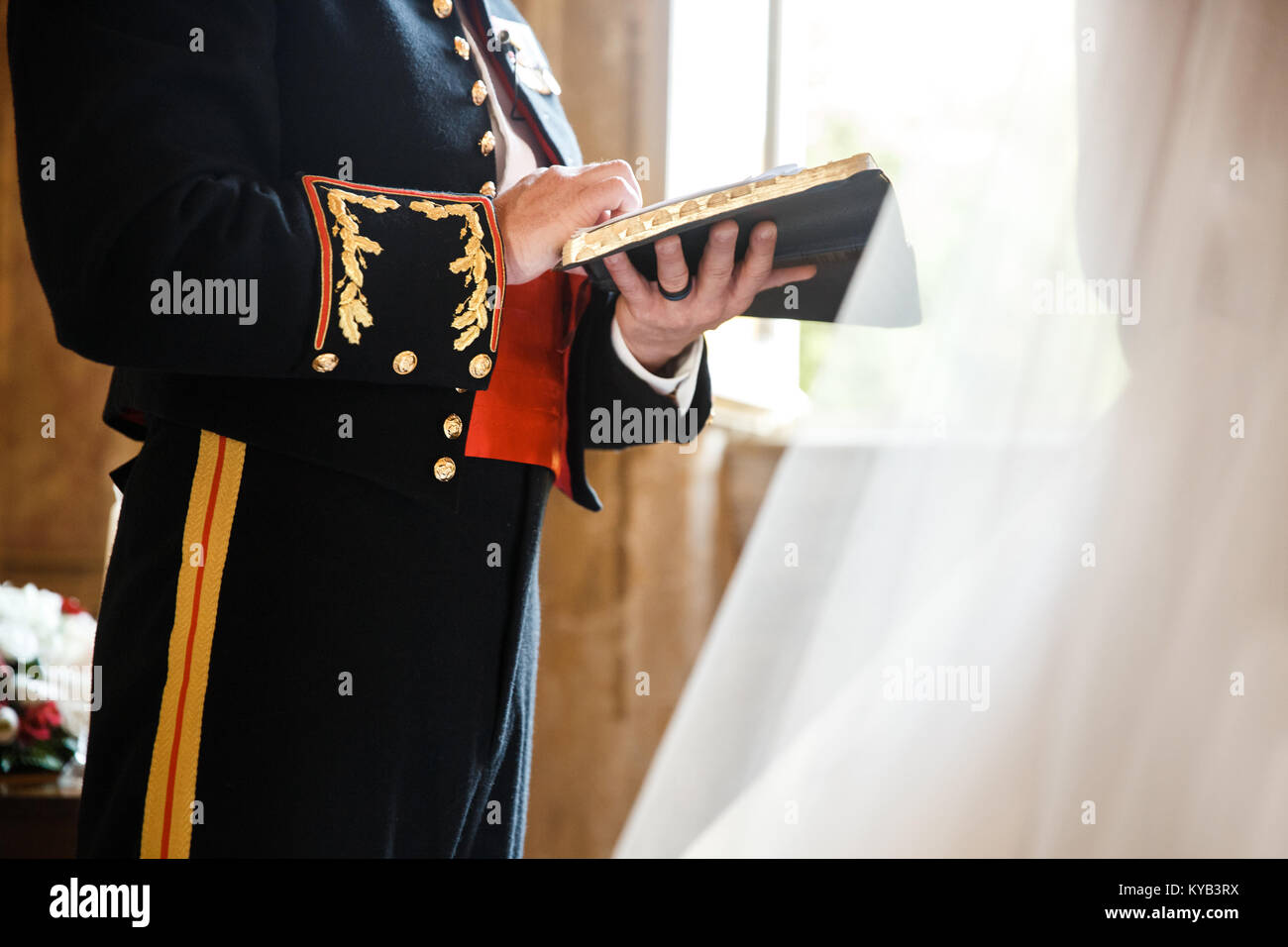 the groom is reading a letter to the bride stock image