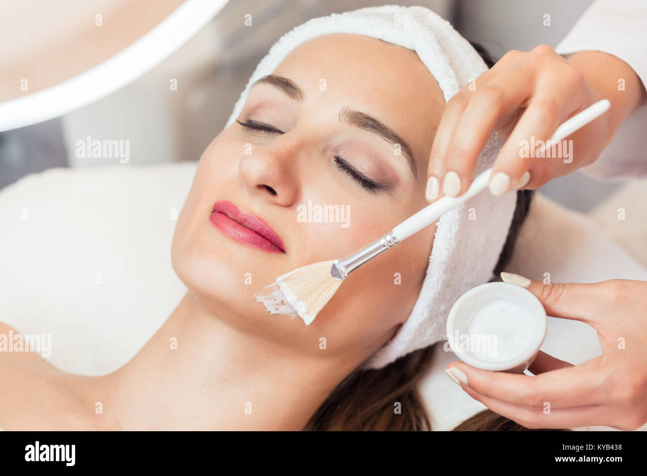Close-up of a beautiful woman relaxing during facial treatment i Stock Photo