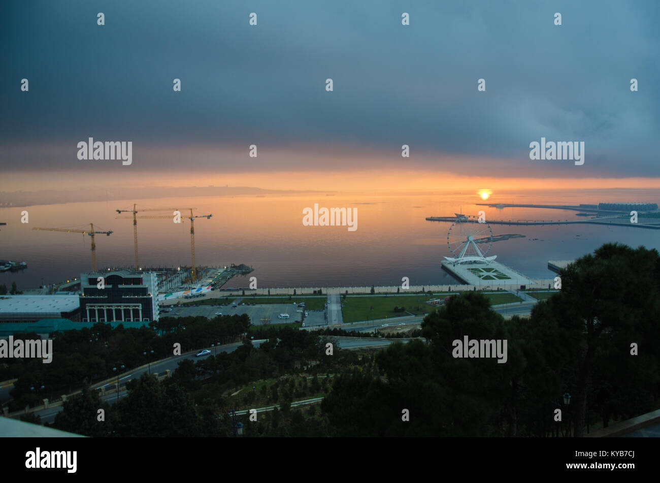 Sunset .The sun goes out on the edge of the Caspian Sea . Amazing view of clear sea landscape with cloudy sky as - Stock Image