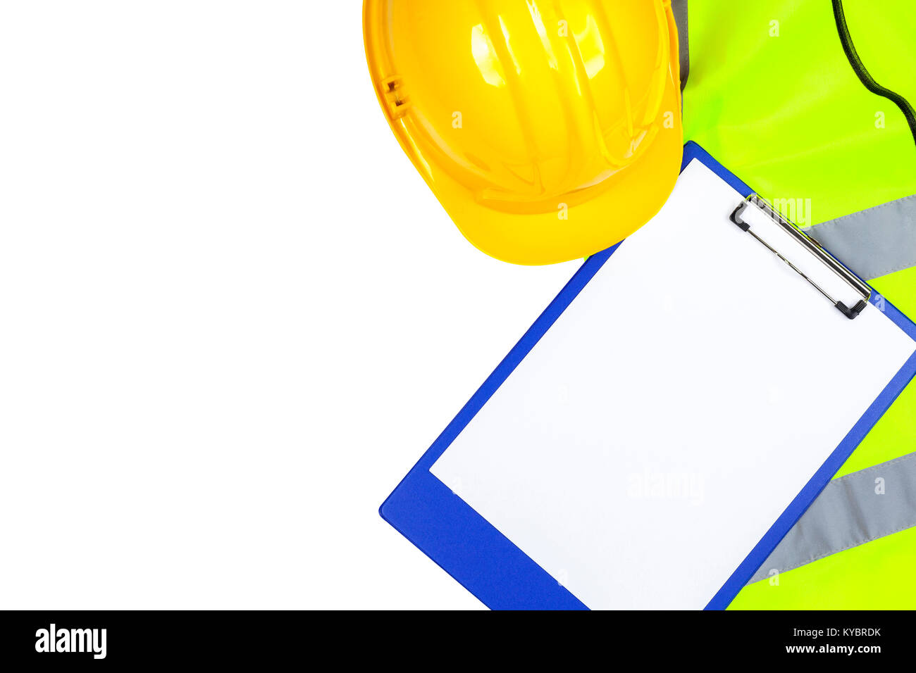 Saftey yellow hi vis vest and hard hat with a blue clipboard isolated on a pure white background Stock Photo