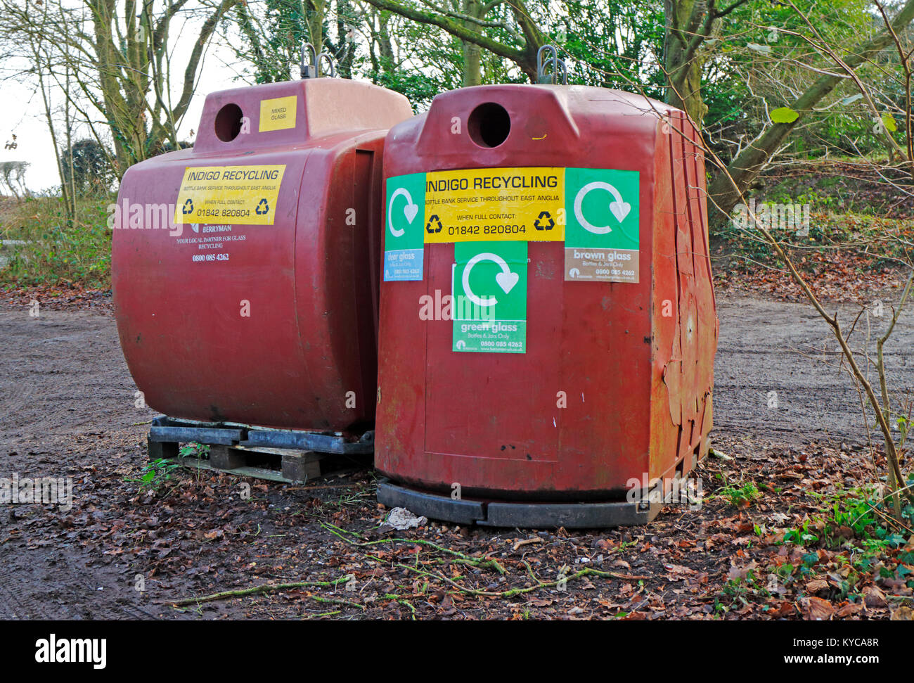 Two glass recycling bins in a public car park at Salhouse, Norfolk, England, United Kingdom, Europe. Stock Photo