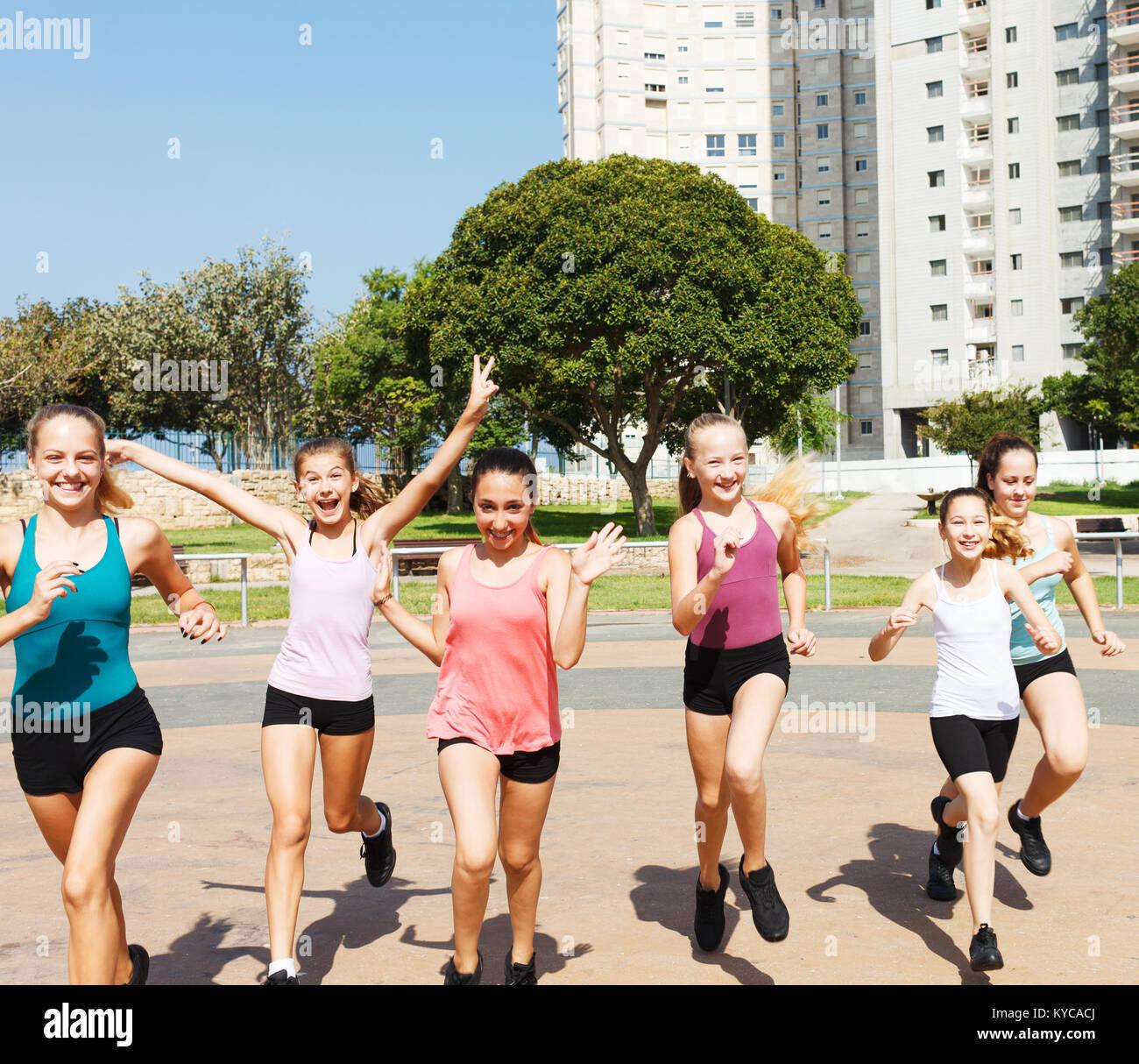 Group of teenage girls running in playground Stock Photo - Alamy