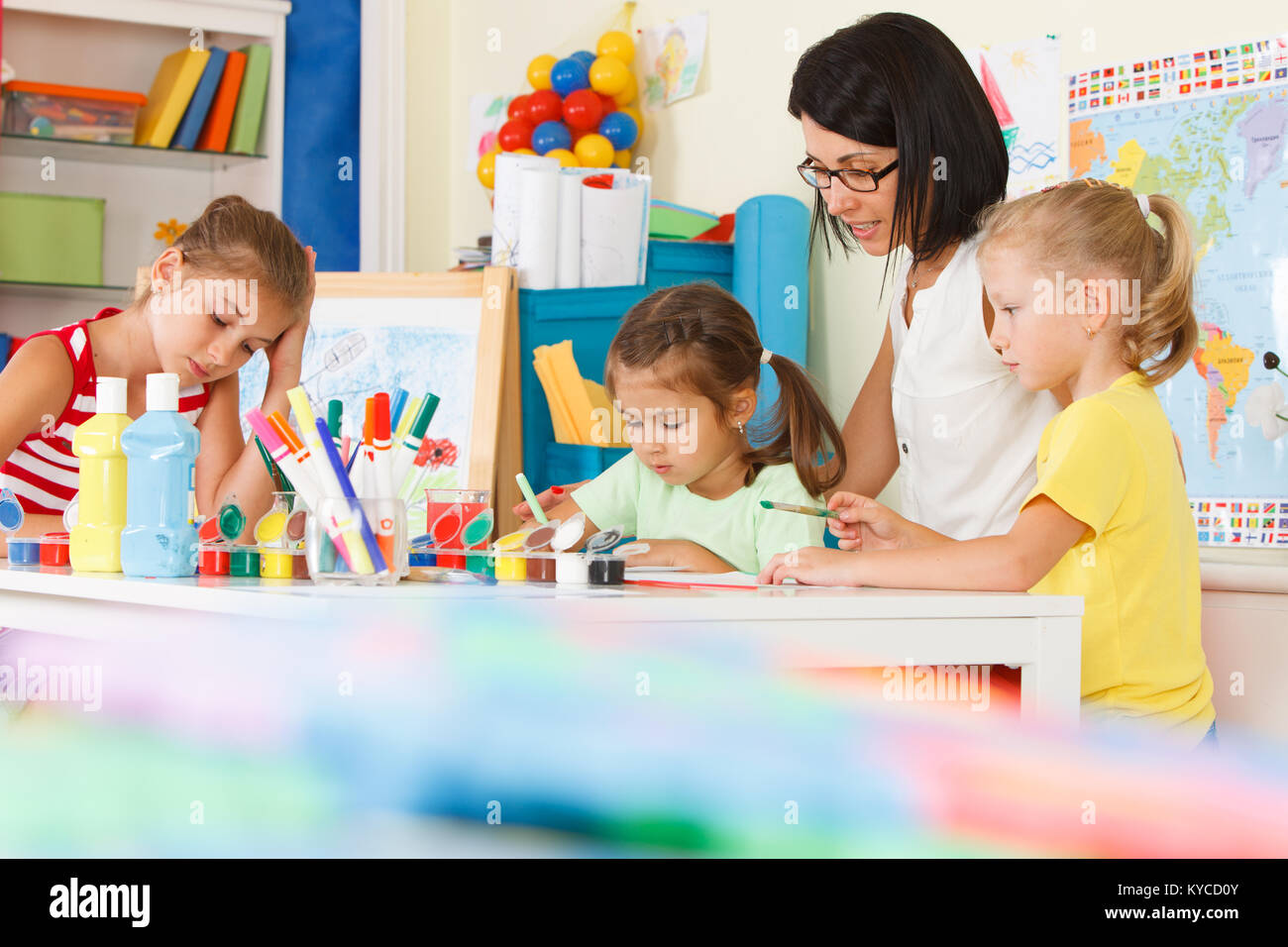 Children with teacher draw in the classroom Stock Photo