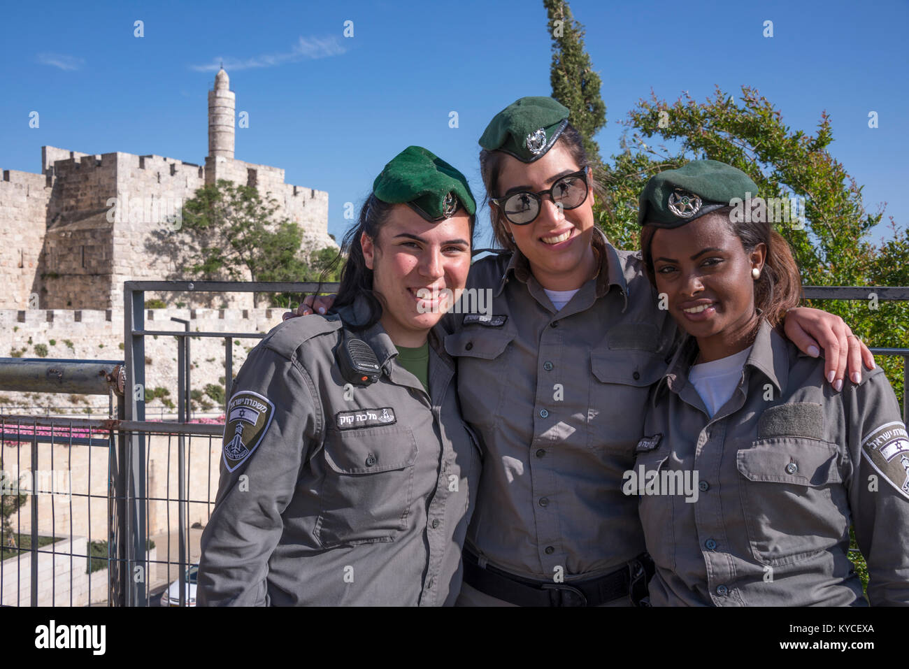 Three young military women in front of the walls and tower of David, in Jerusalem, Israel - Stock Image