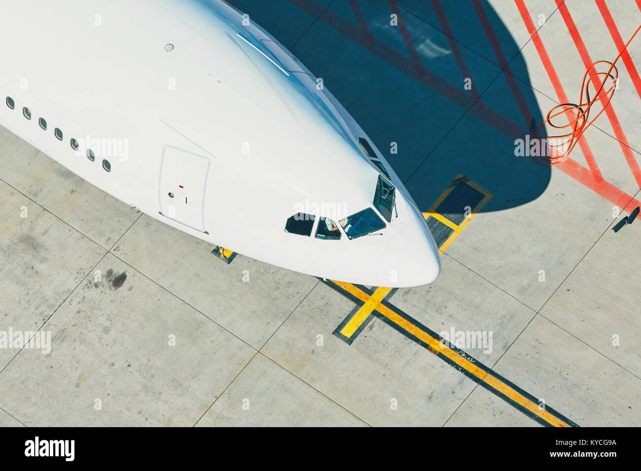 Aerial view of the airport. Airplane is preparation before take off. - Stock Image