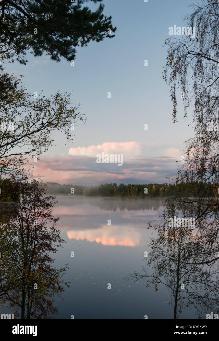 Clouds and calm lake, Sweden - Stock Image