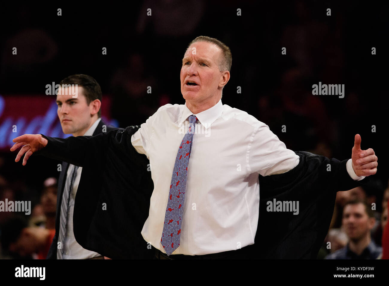 January 13, 2018: St. John's Red Storm head coach Chris Mullin takes his jacket off as he reacts to a late foul - Stock Image