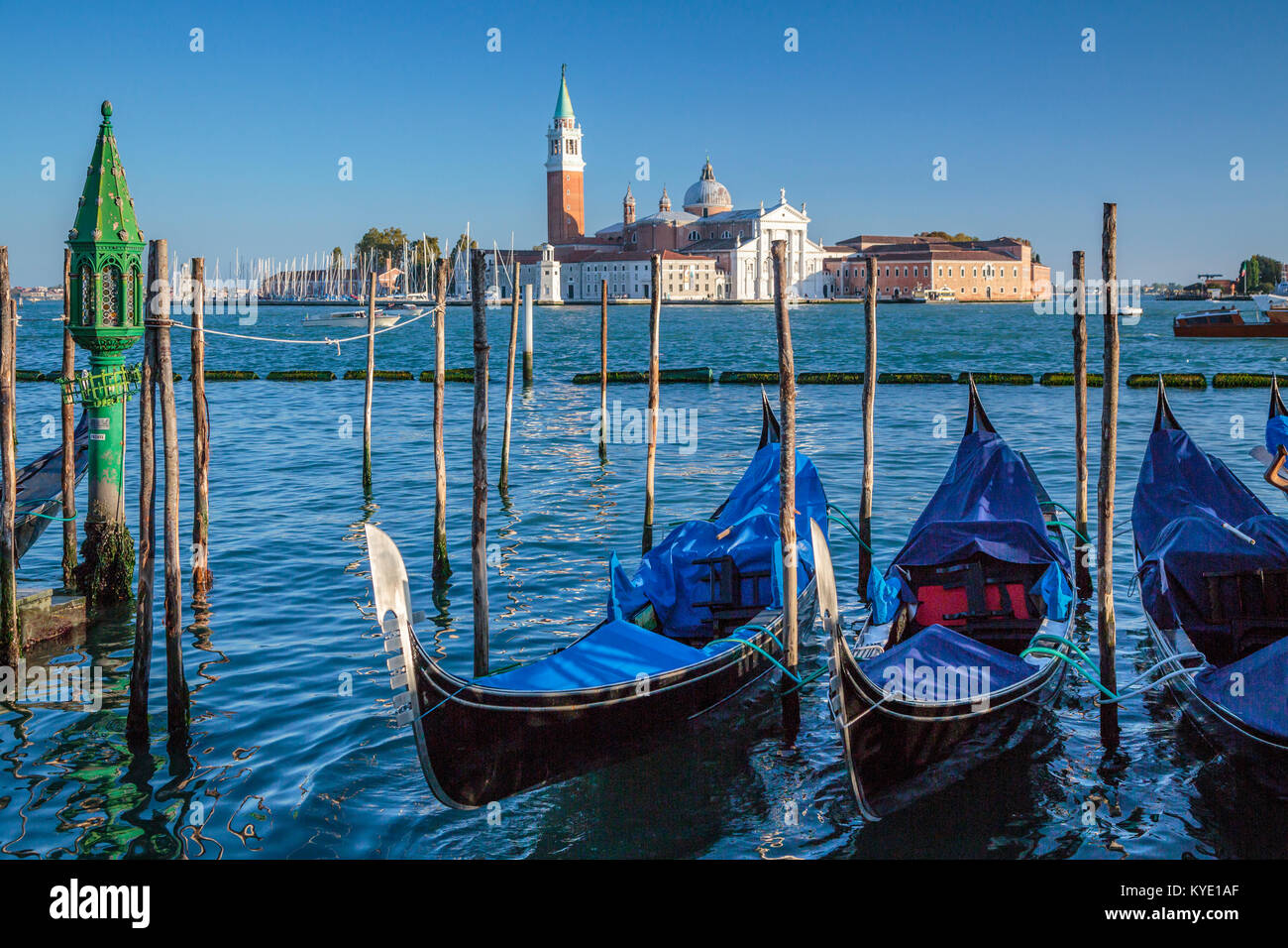 Parked gondolas and the Church of San Giorgio Maggiore in Veneto, Venice, Italy, Europe, - Stock Image