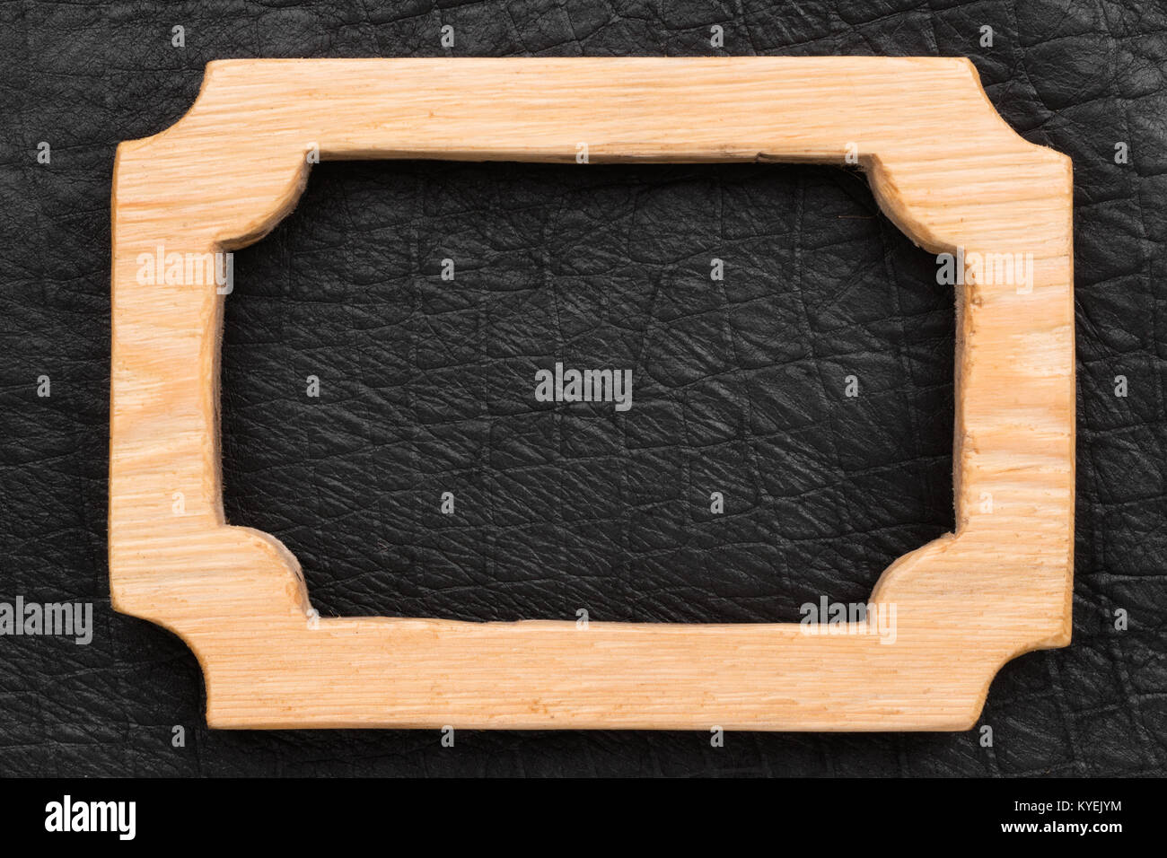 One-piece beautiful wooden frame lying on the black leather. Natural ...