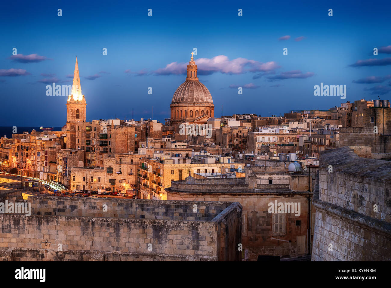 Valletta, Malta: aerial view from city walls at sunset. The cathedral - Stock Image
