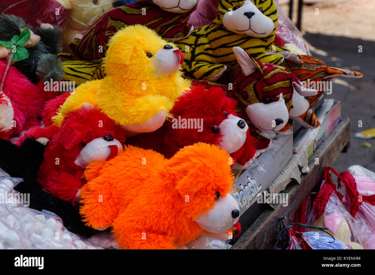 Stuffed fabric colorful toy dogs in local market - Stock Image