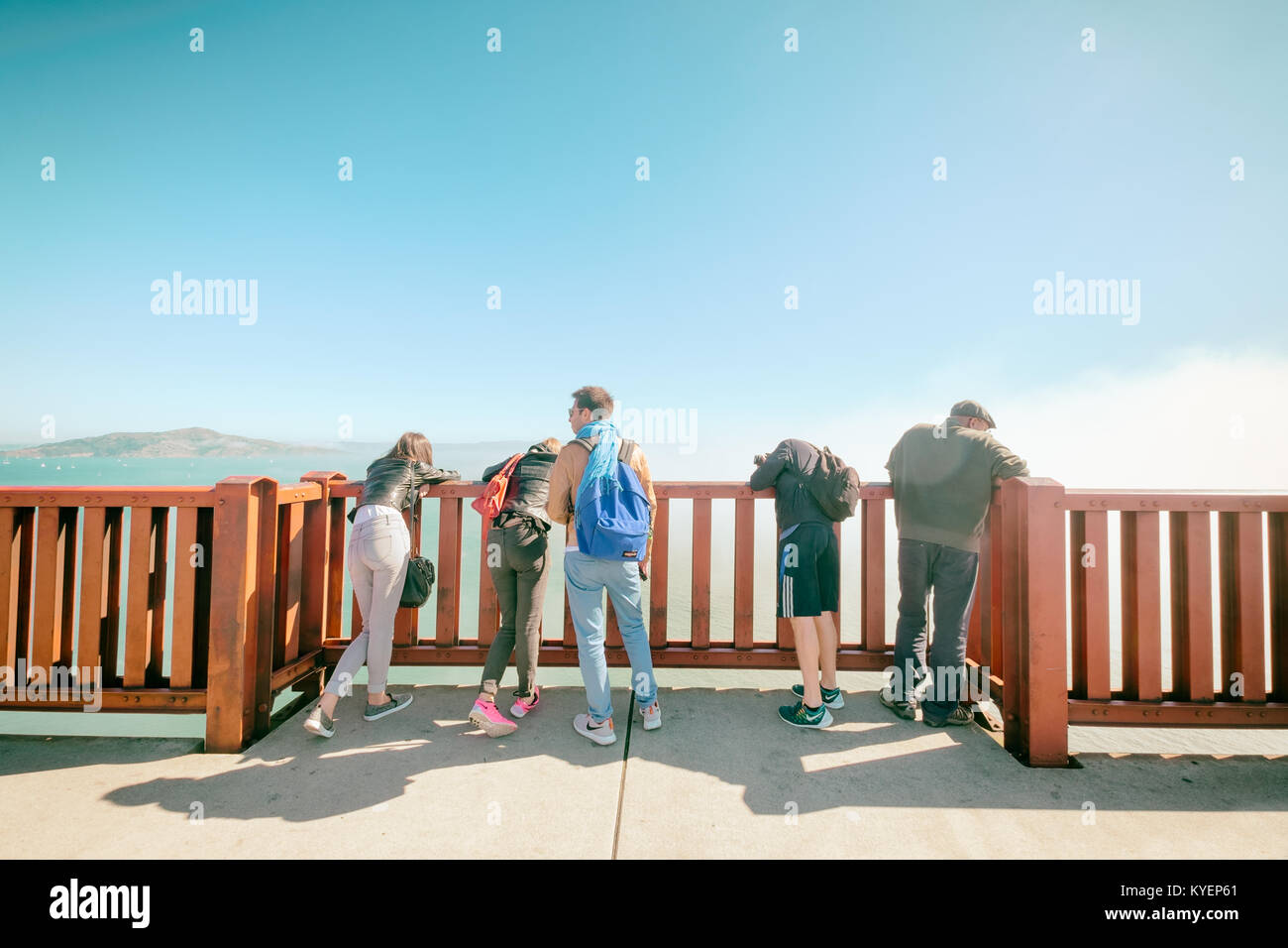SAN FRANCISCO, CA- Oct. 11, 2015: Golden Gate Bridge people on foot lean over the side rail of a bumpout viewpoint - Stock Image