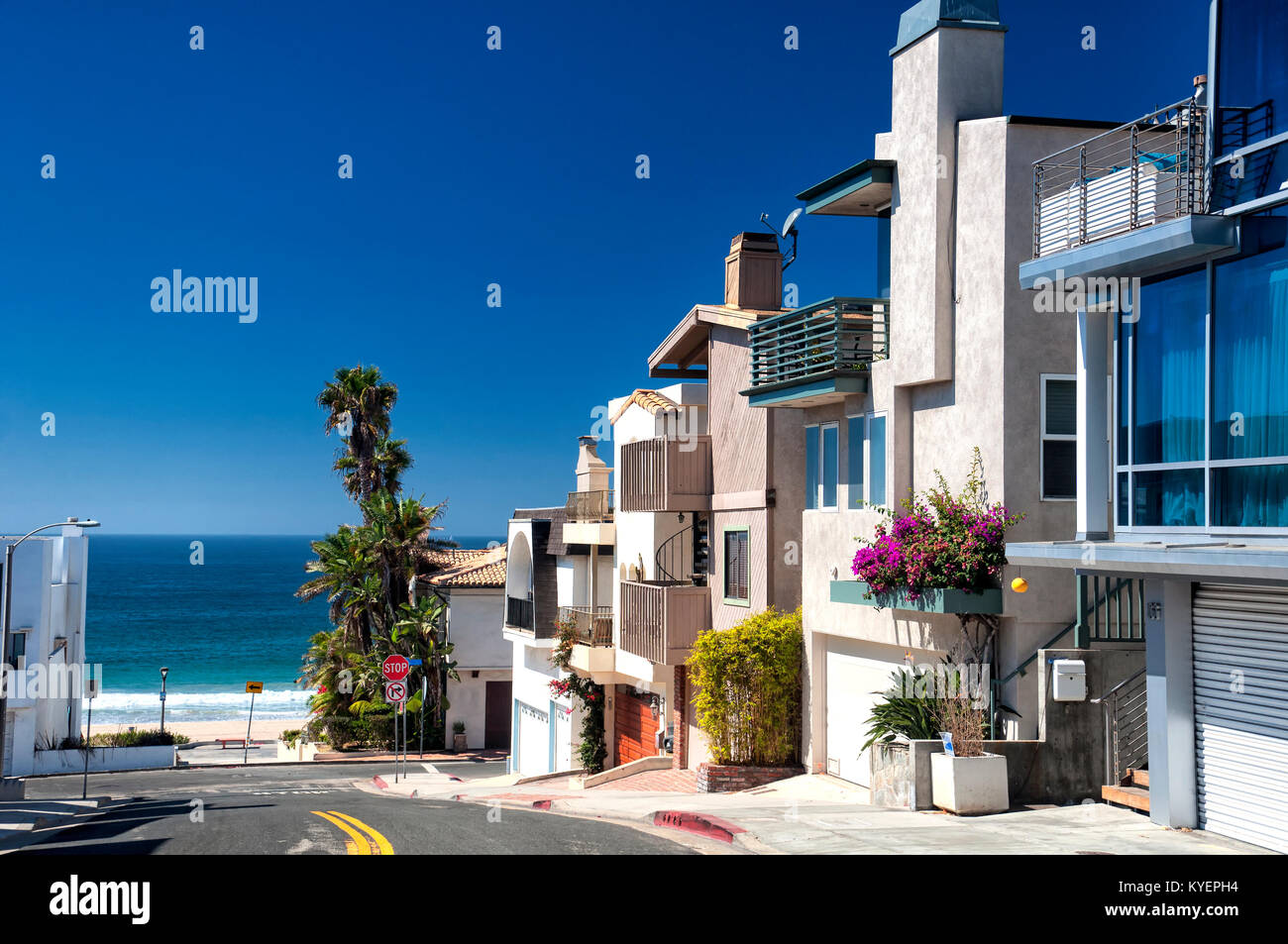 Modern homes lining a street near Manhattan Beach California on a sunny blue sky day. - Stock Image