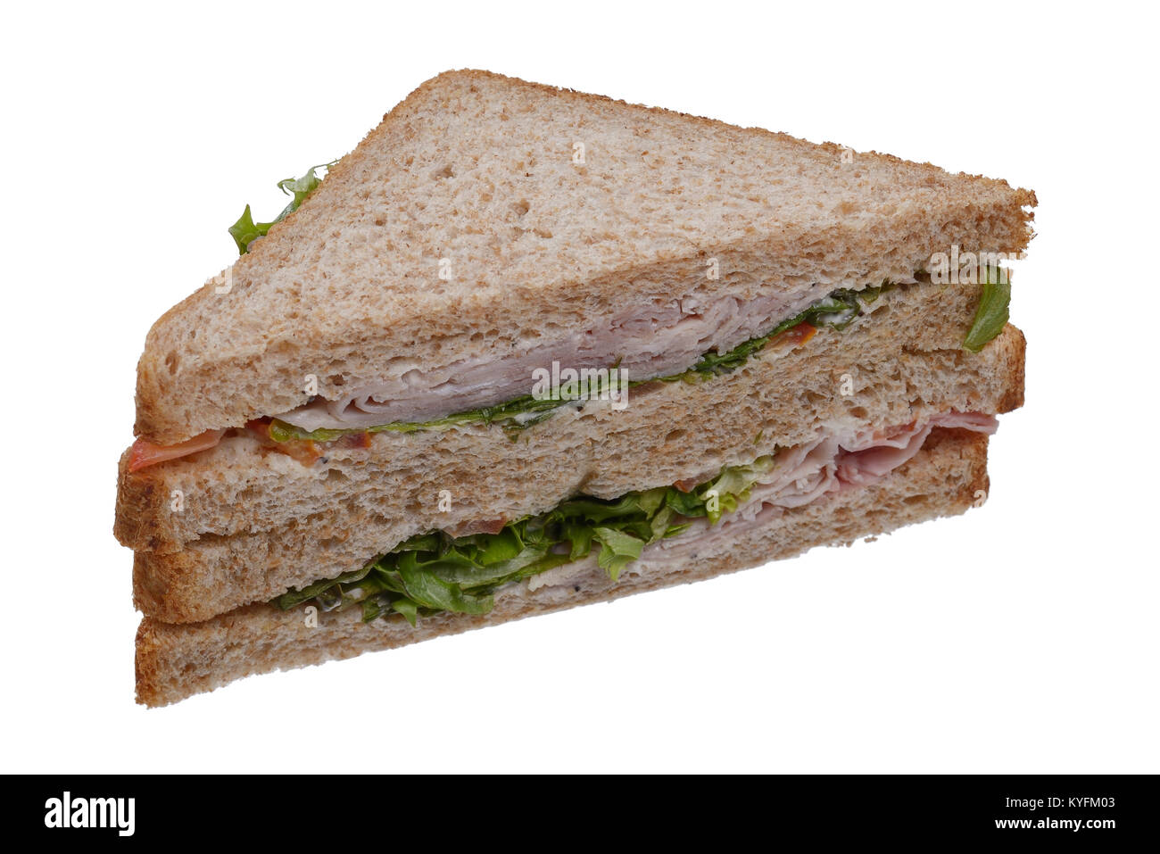 Shop bought ham and salad sandwich on brown bread - Stock Image