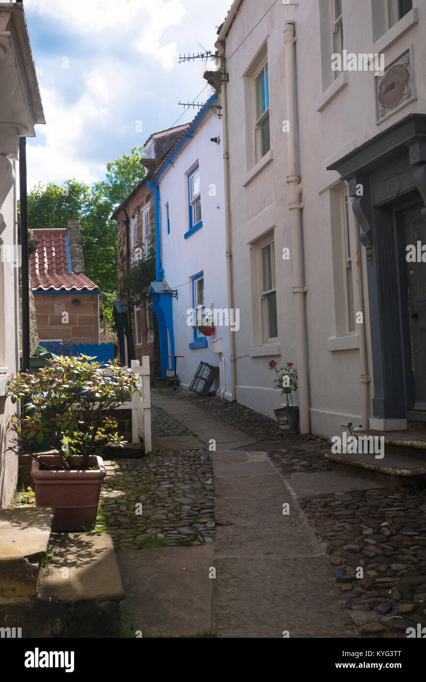 A row of small houses in the coastal village of Robin Hood's Bay, North Yorkshire - Stock Image
