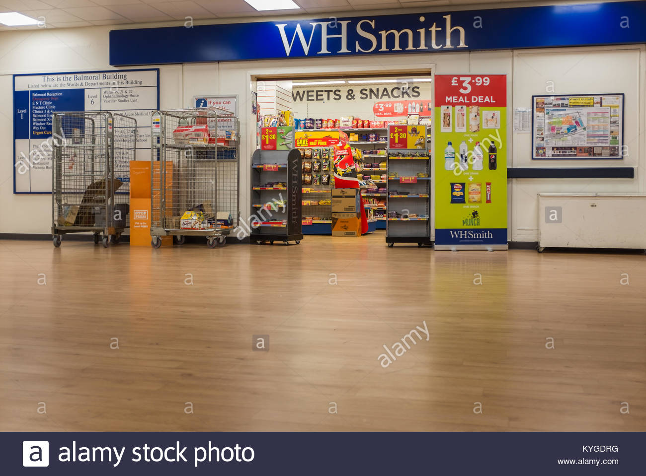 W H Smiths shop advertising offers, various sweets and drinks. Inside an NHS hospital England UK - Stock Image