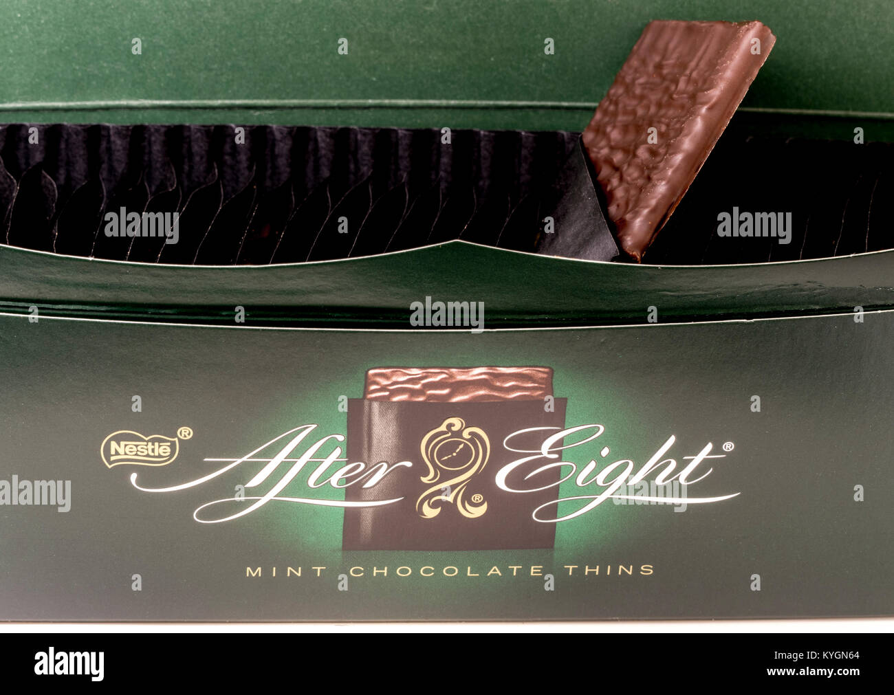 Nestlé After Eight chocolates (After Eights). Closeup of open box and logo, with a square shaped dark chocolate - Stock Image