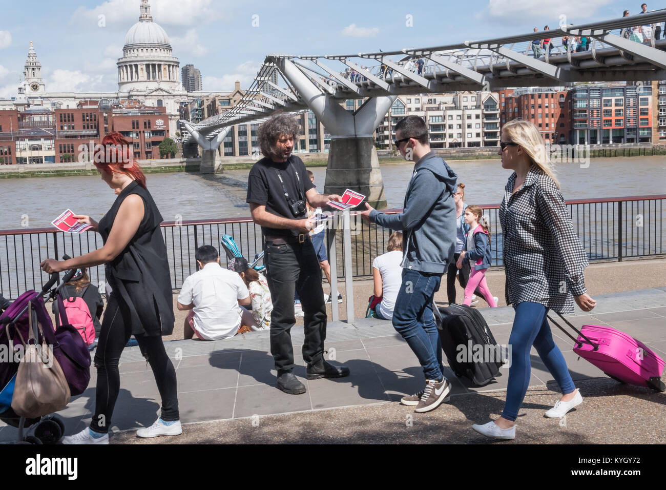 Campaigners handed out leaflets and explained that privatised workers are paid £3 an hour less than directly - Stock Image
