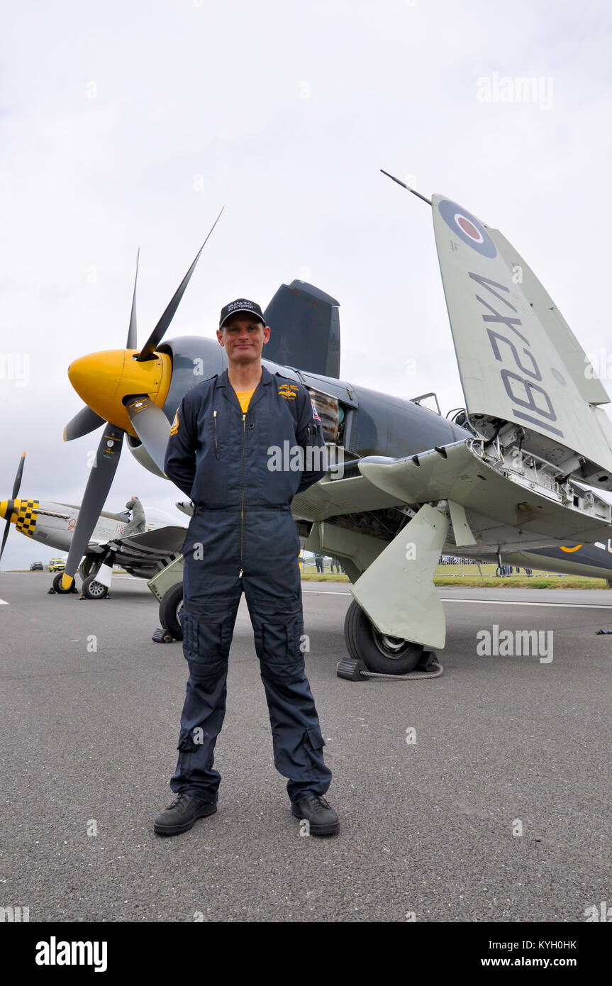 Lt Cdr Chris Götke (CO of the Royal Navy Historic Flight) was awarded the Air Force Cross for safely crash - Stock Image