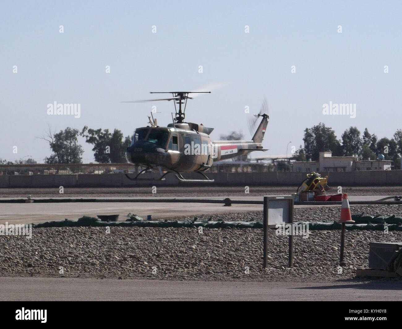 An Iraqi UH-1H hover taxis in for service by members of the Kentucky National Guard's 1204th Aviation Support - Stock Image