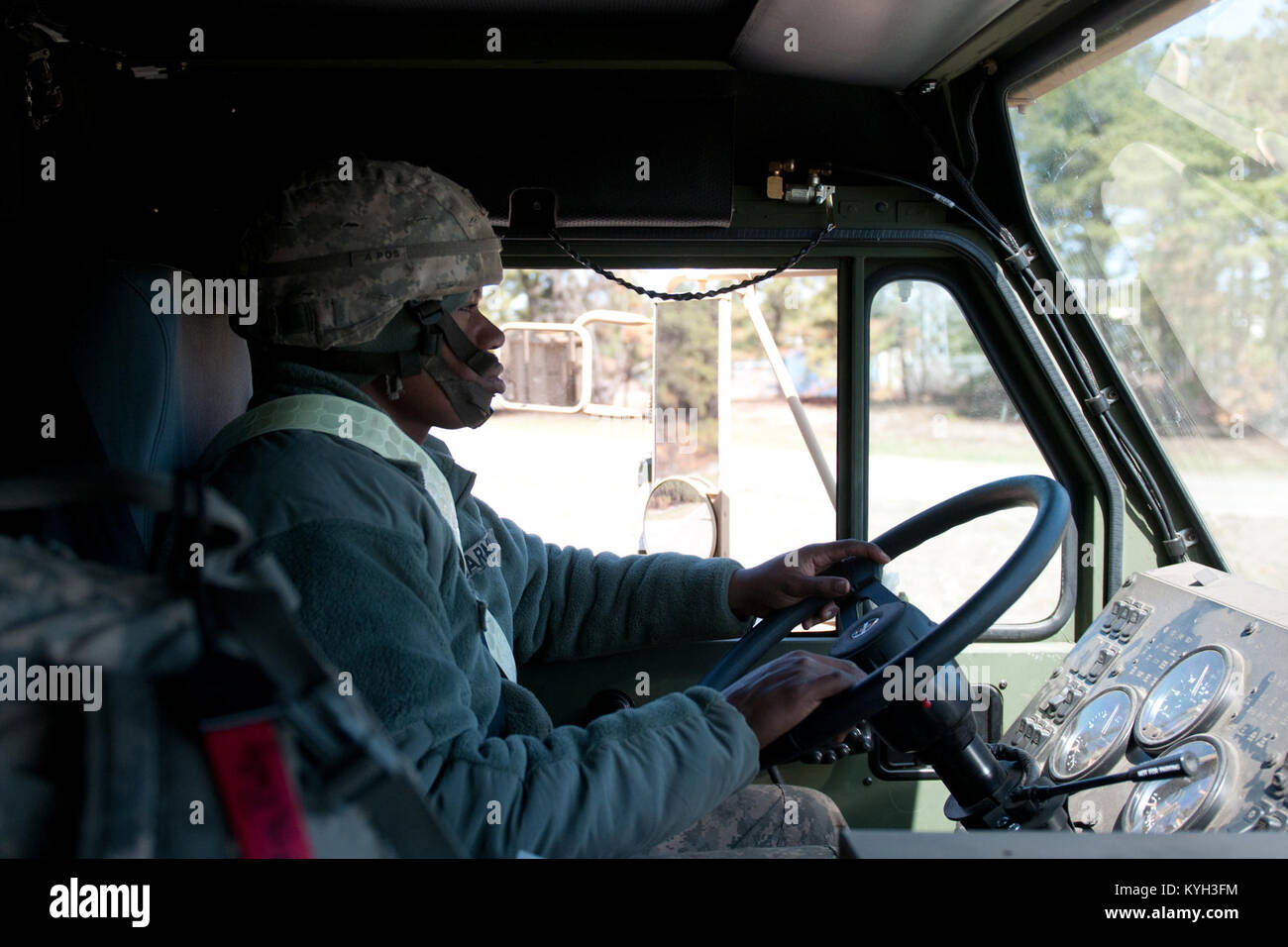 Army Sgt. Billy Artis, a transporter from the 690th Rapid Port Opening Element, drives cargo from the marshaling Stock Photo