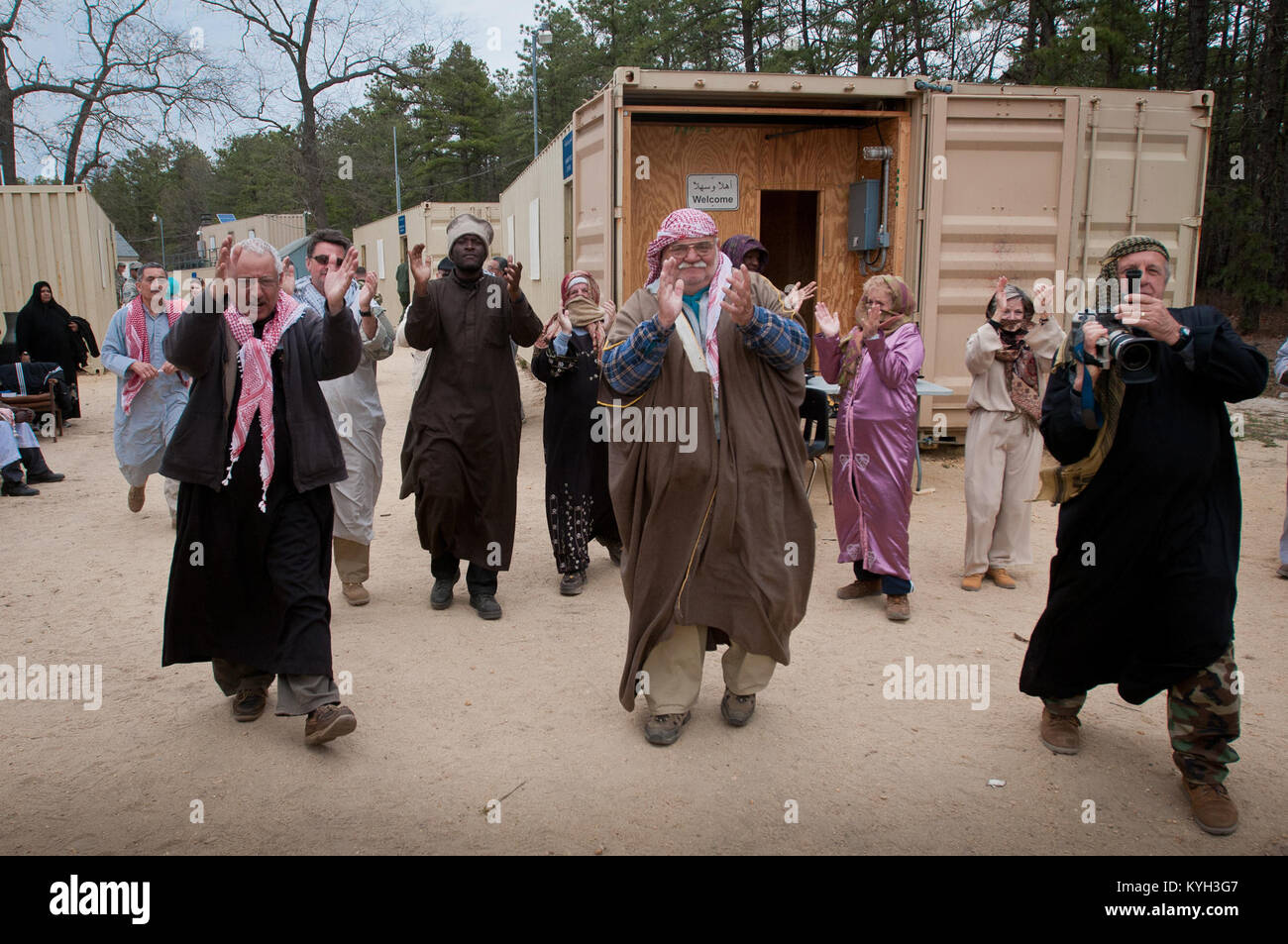 Actors, playing the roles of Arabic citizens in the fictional village of Sabor, Nessor, bid farewell to members Stock Photo