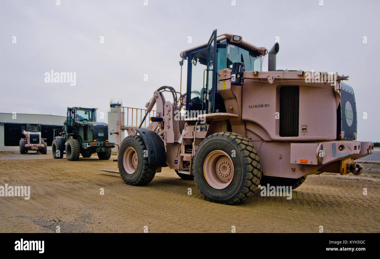 Forklifts line up to marshal cargo arriving at Joint Base McGuire-Dix-Lakehurst, N.J., on March 28, 2012 during Stock Photo
