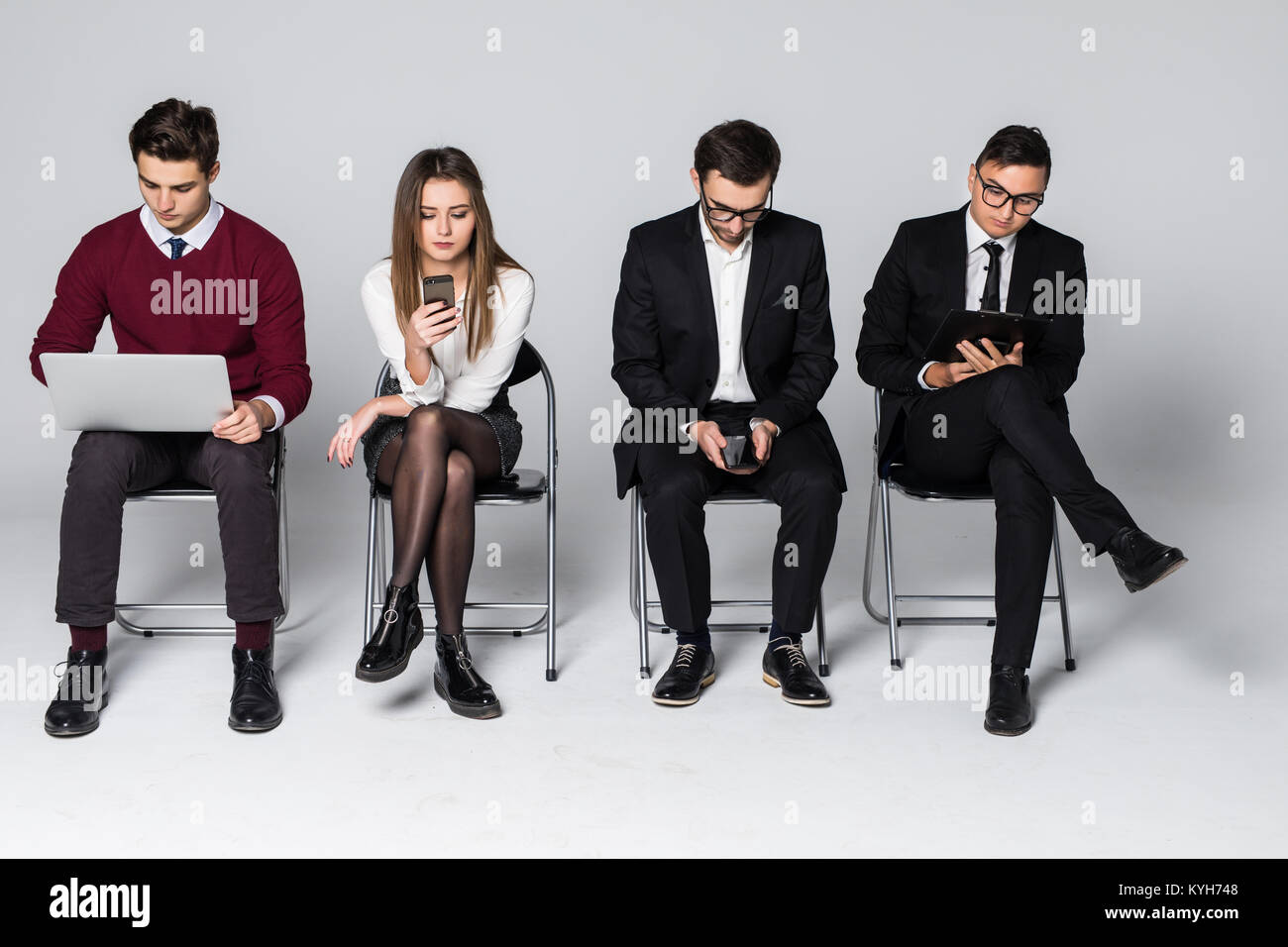 Stressful moment for people wait in queue. Nervous candidates for prestigious job wait with anxiety for interview, - Stock Image