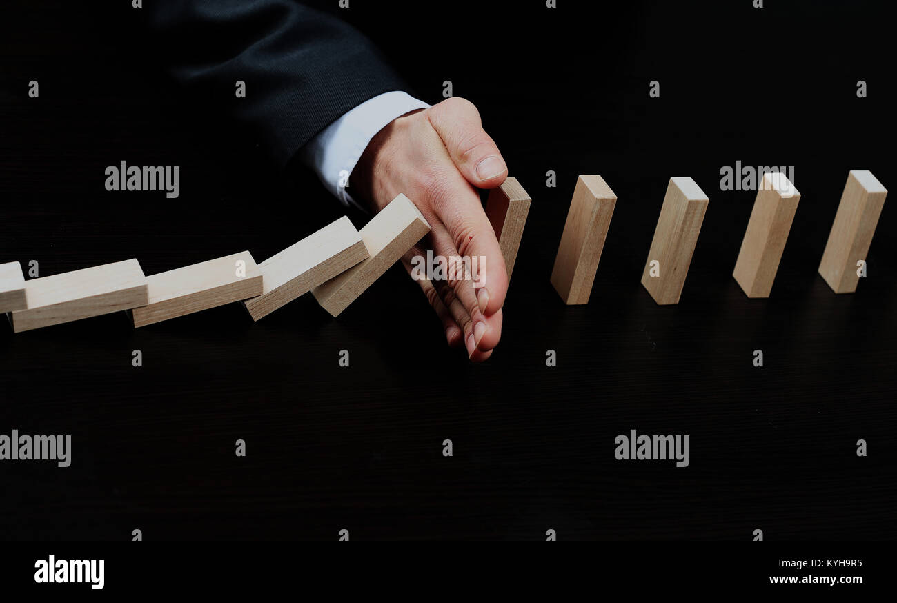male hand placing wooden block on a tower. planing and strategy concept. - Stock Image