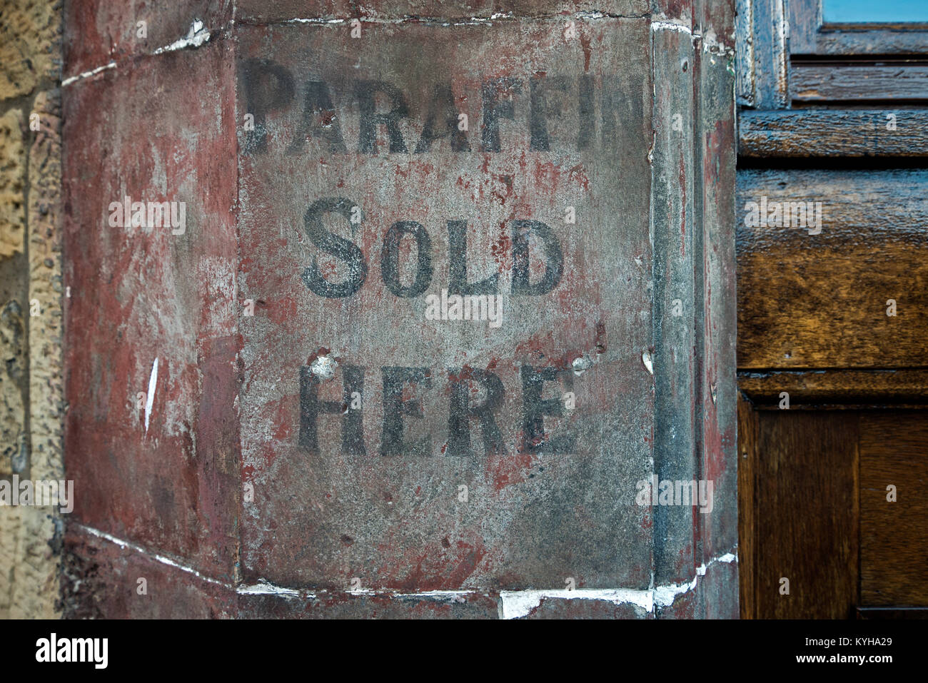 Ghost sign on a wall outside a shop in Edinburgh. - Stock Image
