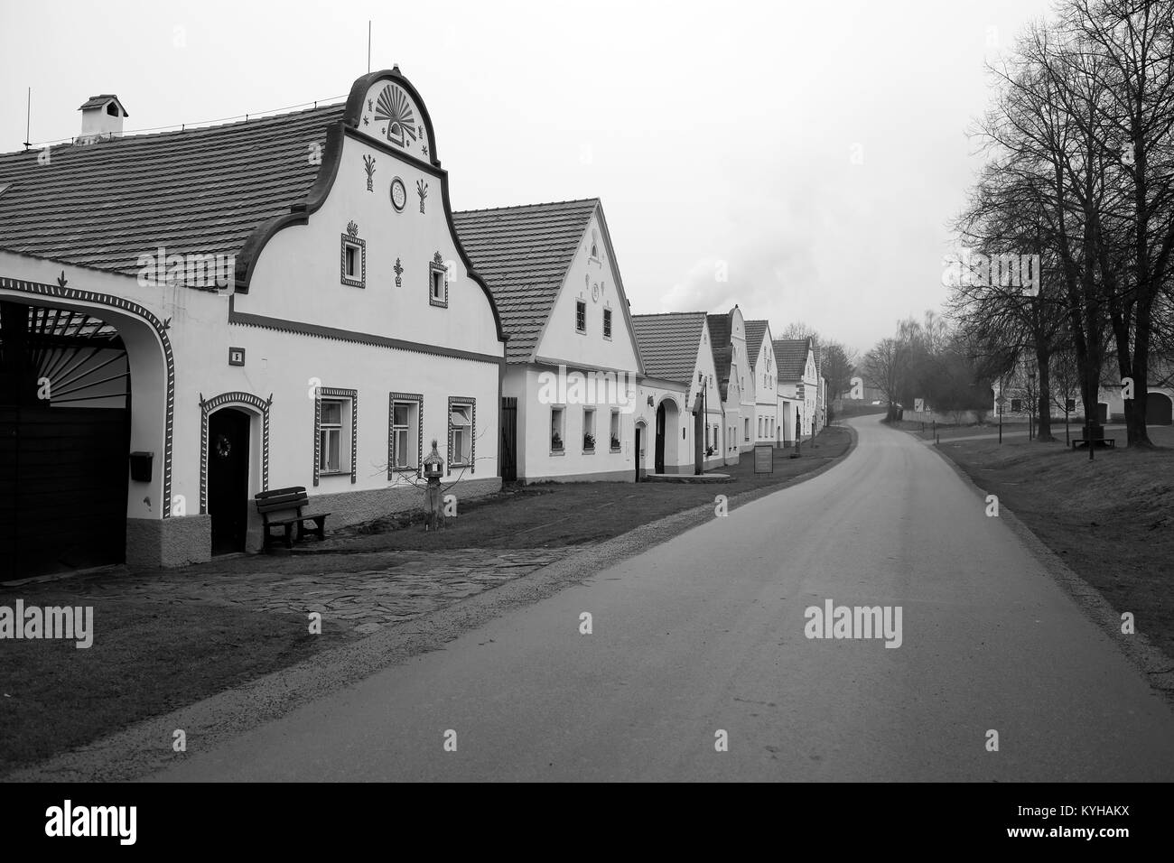 Old houses in the South Bohemian Folk or Rural Baroque style (18th- and 19th-century) in Holasovice village, South - Stock Image