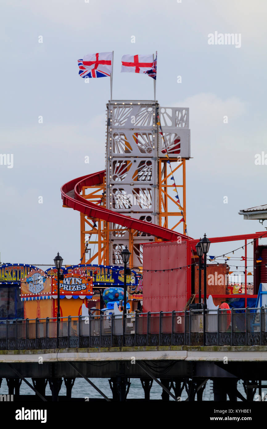 Helter skelter and other amusements at the end of the Victorian pier at Paignton, South Devon, UK - Stock Image