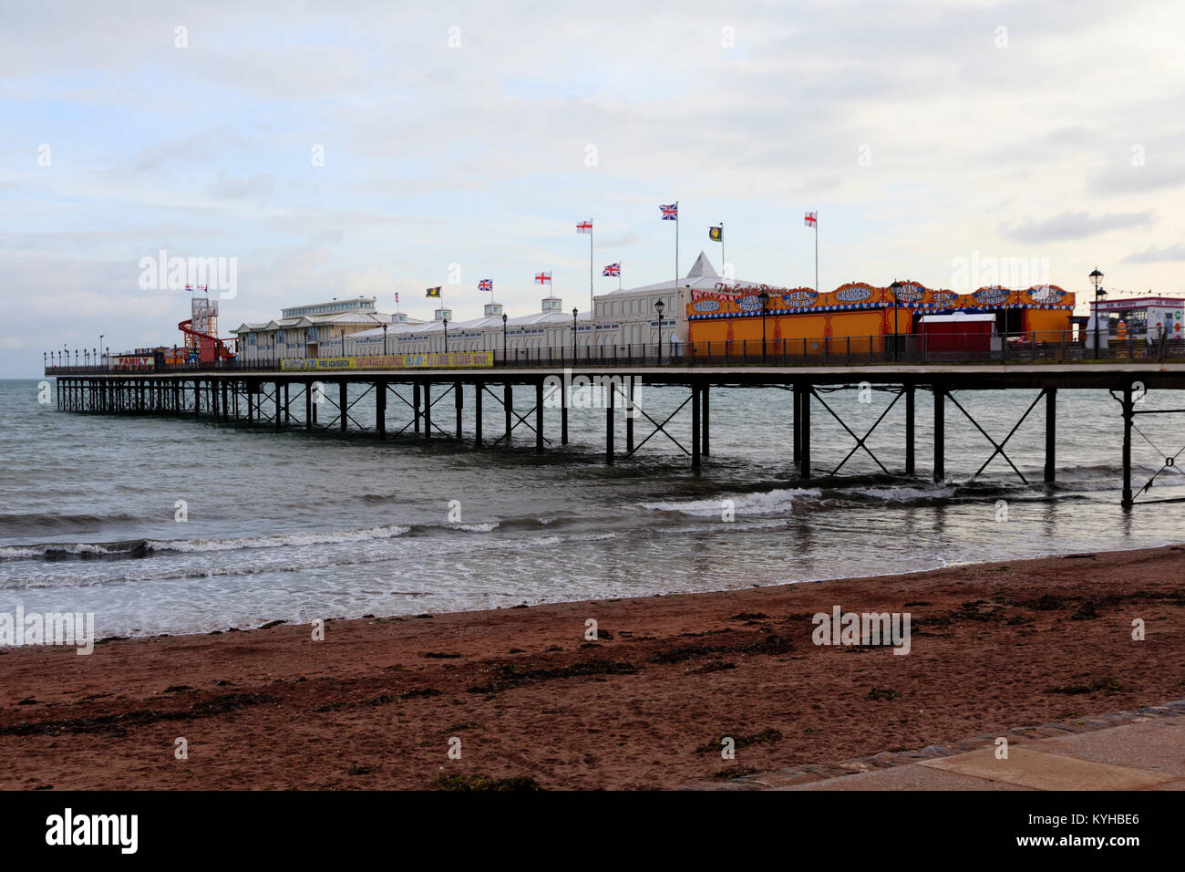 Amusements and arcades cover the length of the Victorian pier at Paignton, South Devon, UK - Stock Image