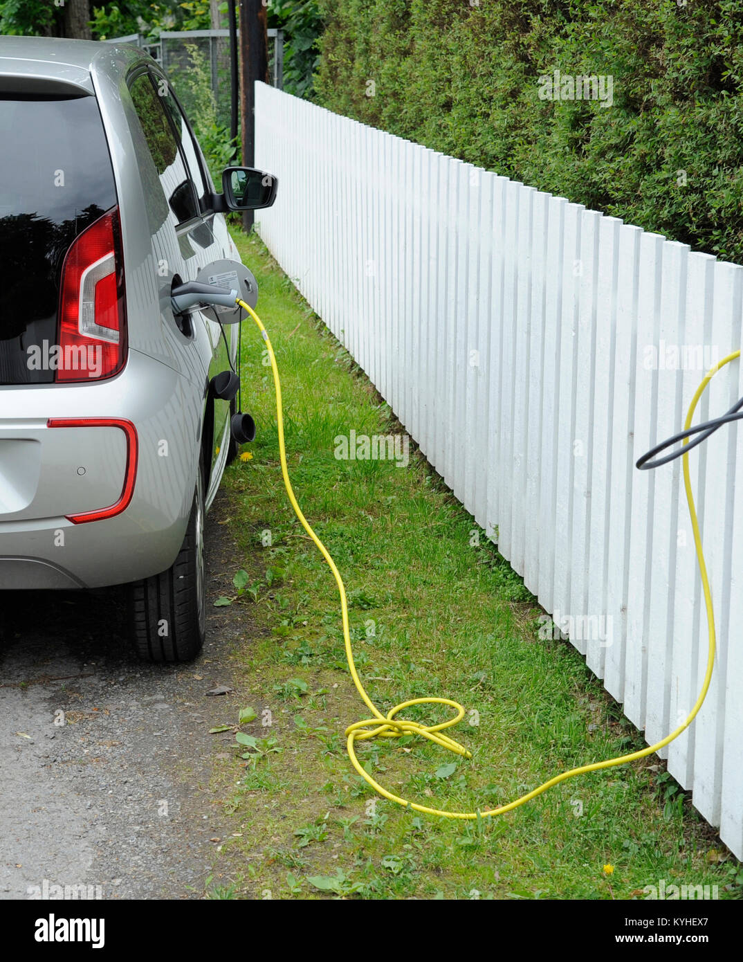 Electric car charging the batteries in a charging point. - Stock Image