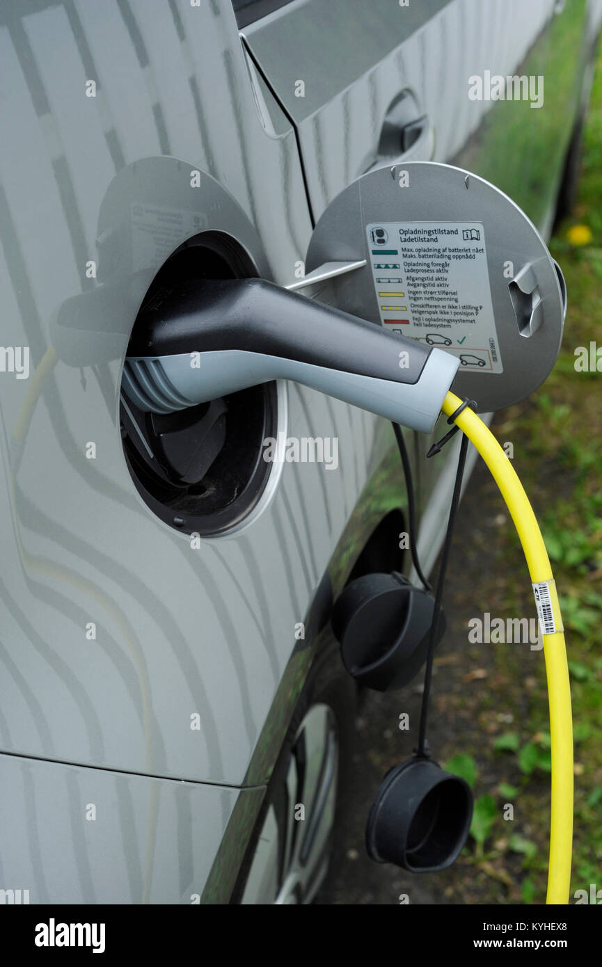 Electric car charging the batteries in a charging point. Stock Photo