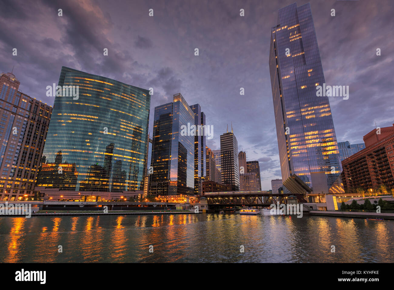 Chicago city skyline and Chicago river at dusk, Chicago, Illinois. - Stock Image