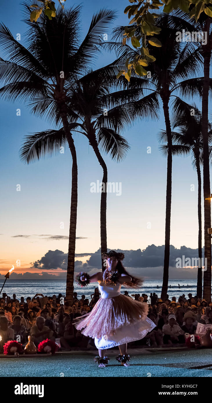 Waikiki Beach, Honolulu, Oahu Island, Hawaii - September 27, 2017: attractive female hula dancer on a small stage, - Stock Image