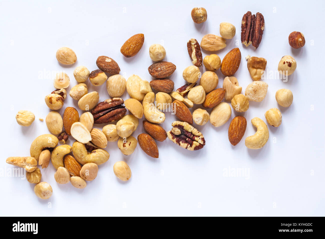Tesco finest roasted nut selection spread out isolated on white background. Mixed roasted nuts delicately seasoned - Stock Image