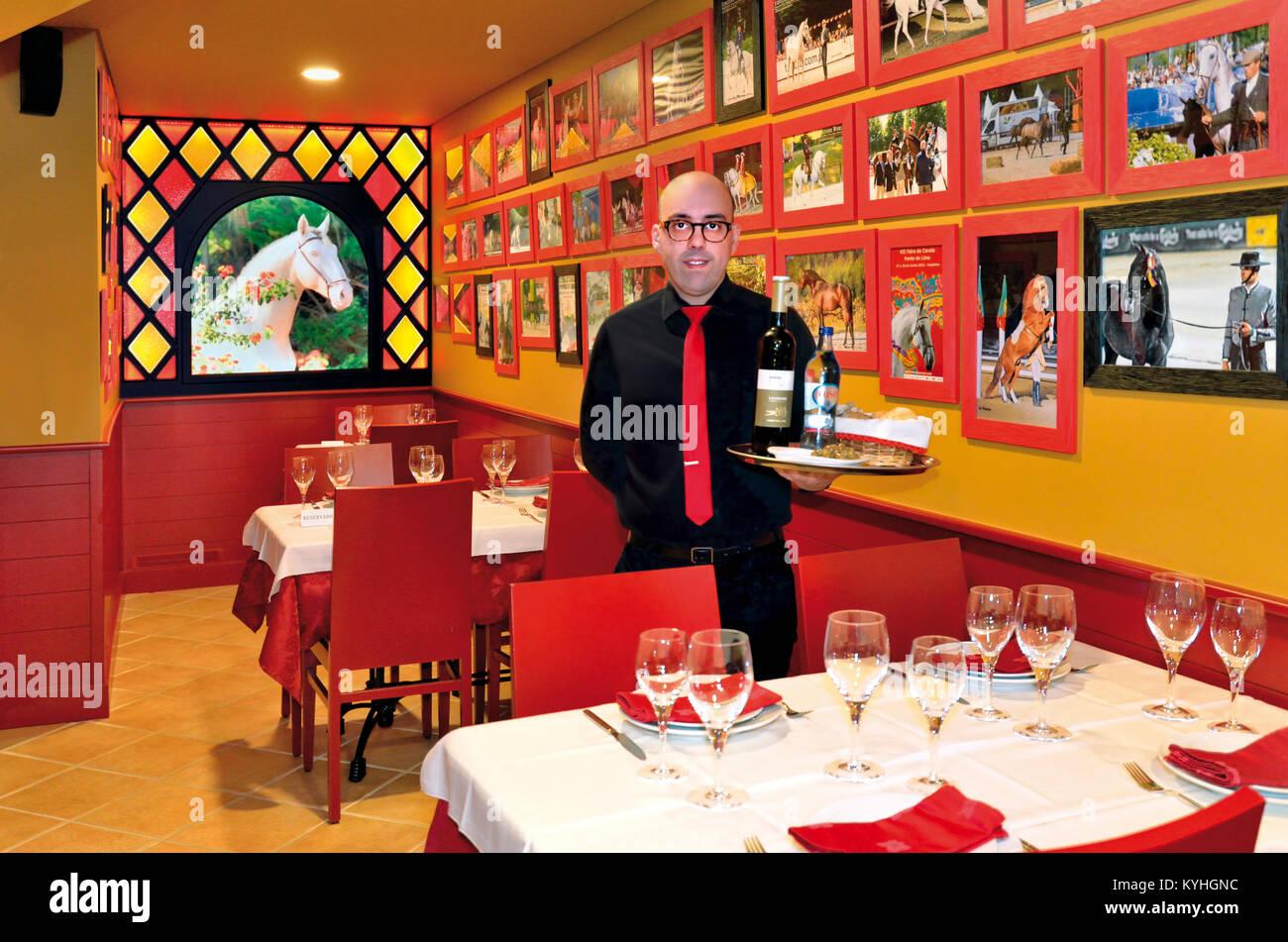 Fernando Lima posing in his traditional restaurant  Taverna Vaca das Cordas in Ponte de Lima, Portugal - Stock Image