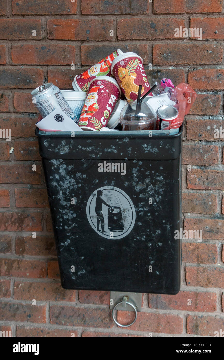 Discarded coffee cups and drinks cans in rubbish bin - Stock Image