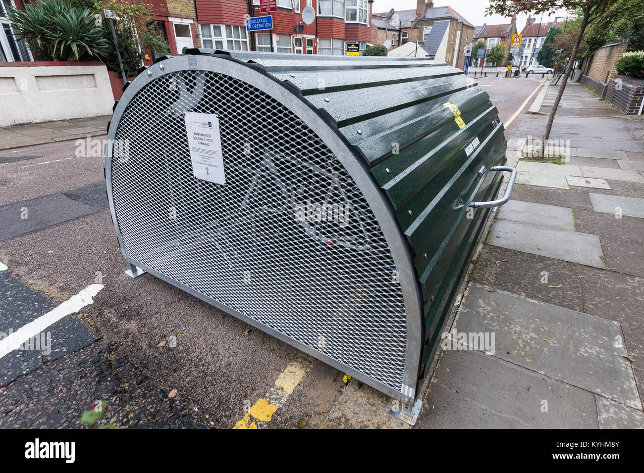 Secure bikehanger cycle parking supplied by The Gardens Residents Association, London Borough of Haringey, London - Stock Image
