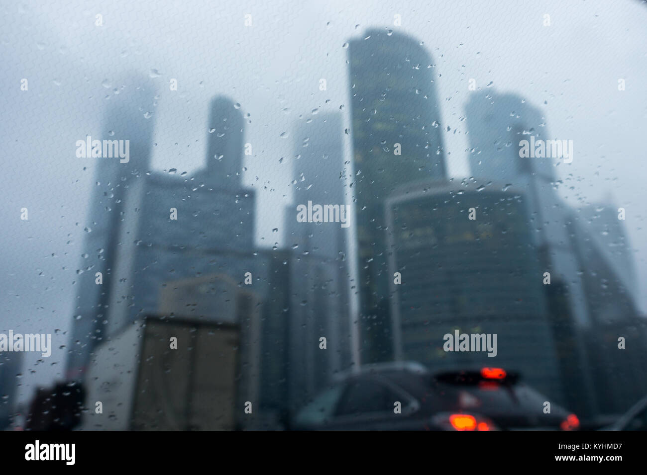 View of houses through windshield of car in rain - Stock Image
