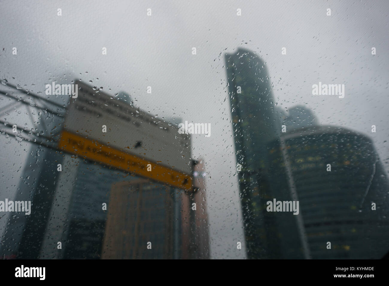 View of city through windshield of car in rain - Stock Image