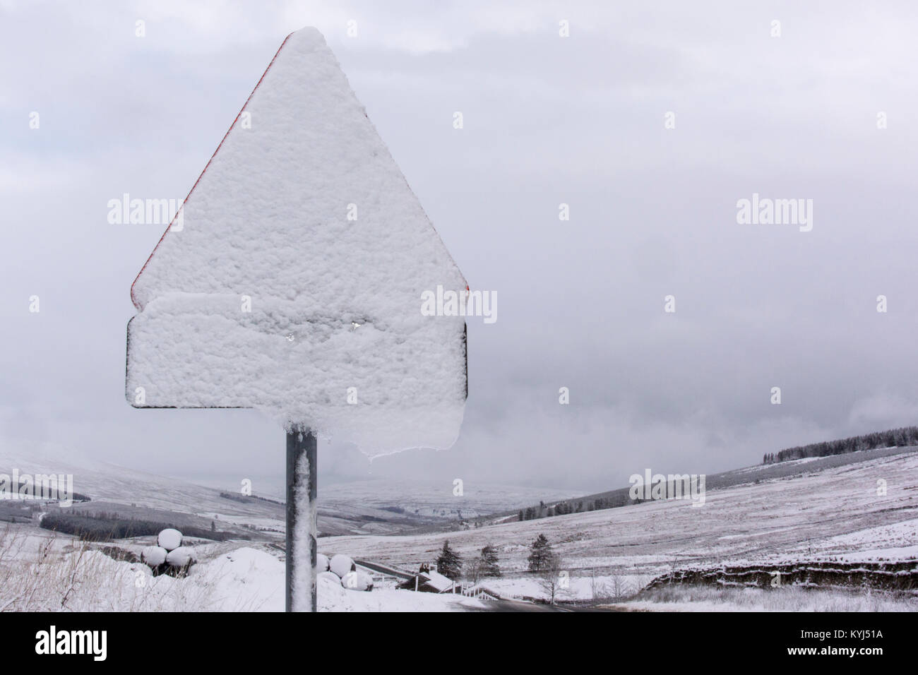 Snow covered road sign in North Yorkshire, UK. Stock Photo