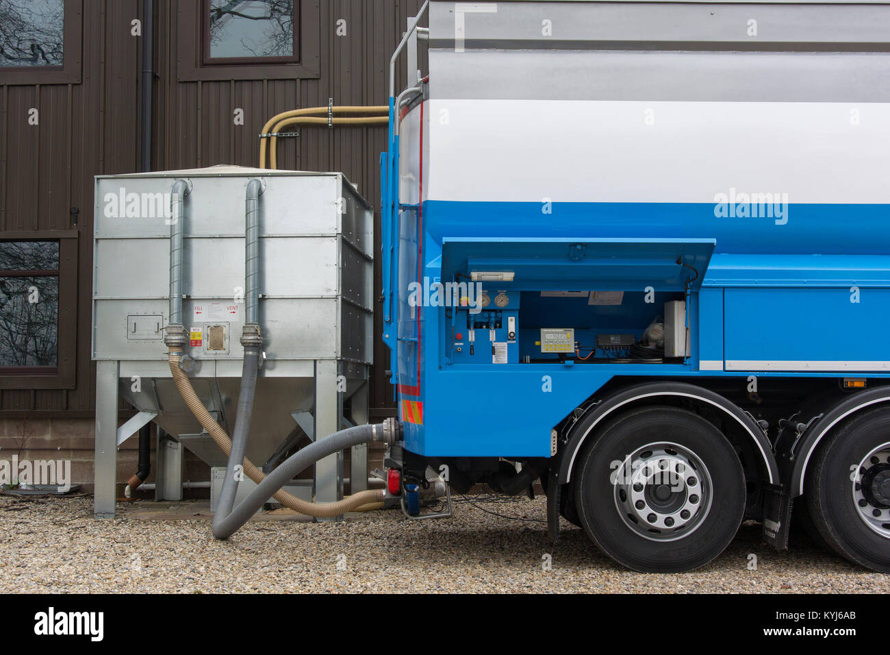 Wood pellets being delivered into a bulk hopper for use in Bio Fuel heater at an industrial park, UK. Stock Photo
