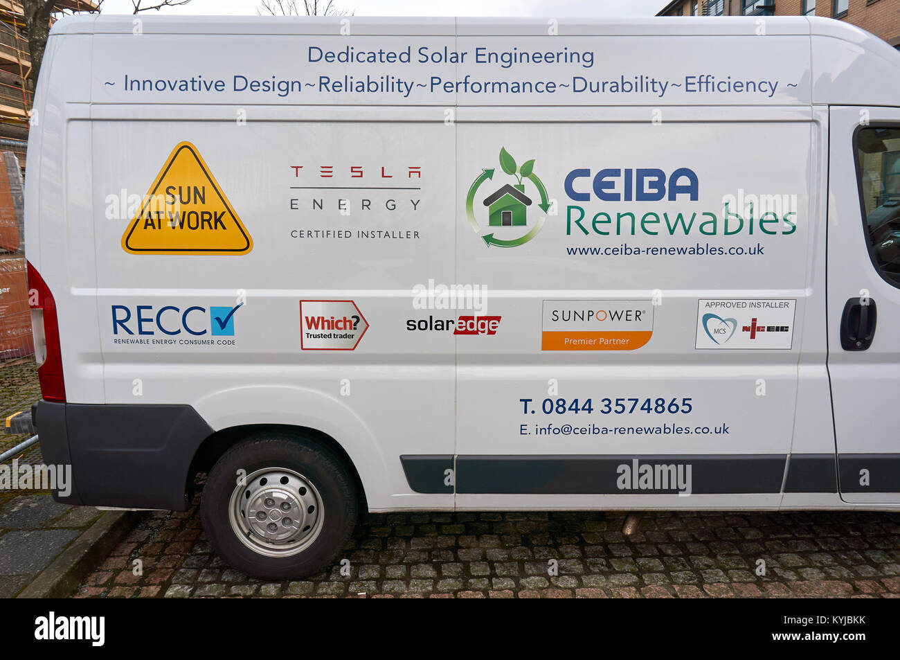 White van of engineering company specialising in renewable energy solutions, with many brand names on the side. - Stock Image